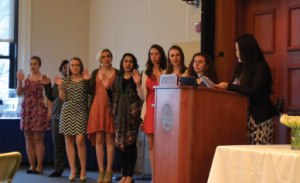 Members of the new SGA are sworn in by current president Sandy Lor.