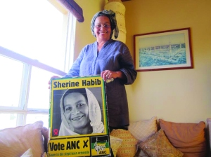 Habib holds her campaign poster