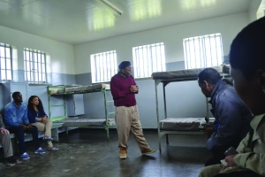 Ntando Mbatha looks at the bunk bed where he spent his nights during his incarceration on Robben Island. He had the top bunk, but once slept on the floor when a hunger strike left him too weak to climb the ladder.
