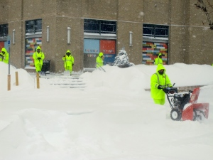 Clearing snow outside the Landmark Center in the Fenway area.