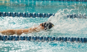 A swimmer racing to the finish