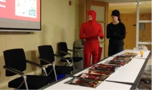 Two costumed club members giving a PowerPoint presentation