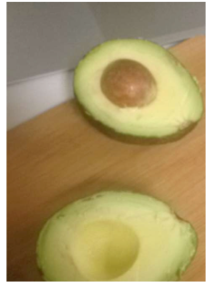 Prepping an avocado for sandwich-making