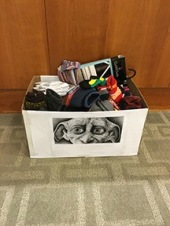 A donation box full of socks for Rosie's Place, sponsored by Dobby