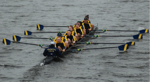 The Simmons crew team charges through Lake Quinsigamond